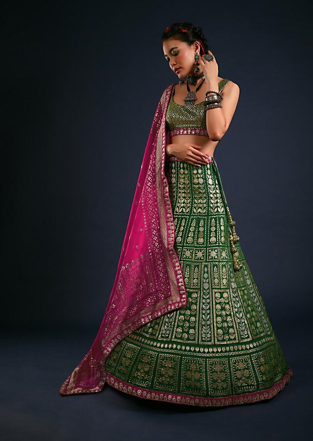 Forest Green Lehenga Set In Brocade Silk With Golden And Silver Woven Kali Design And Contrasting Fuchsia Dupatta Online - Kalki Fashion