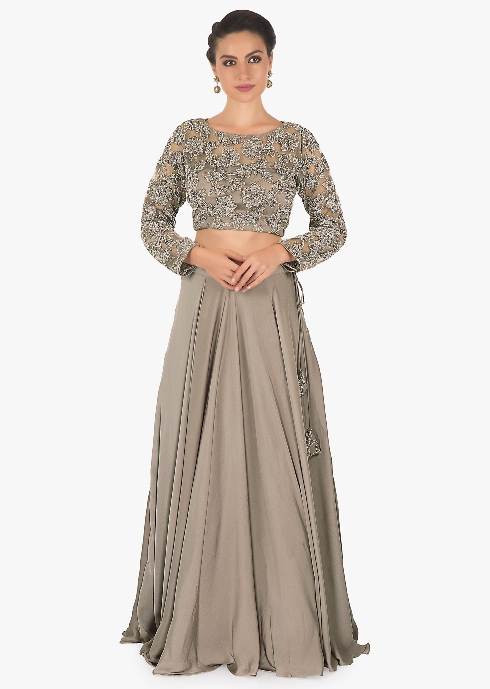 87bc9306b4 Fossil grey net lehenga matched with a bateau neck along with fossil grey  net blouse and a satin crepe net tissue dupatta only on kalkiMore Detail