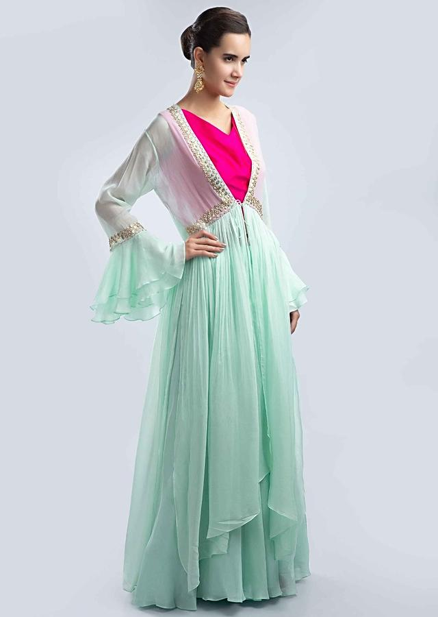 Fuchsia pink crop top with contrasting mint green skirt and jacket only on Kalki