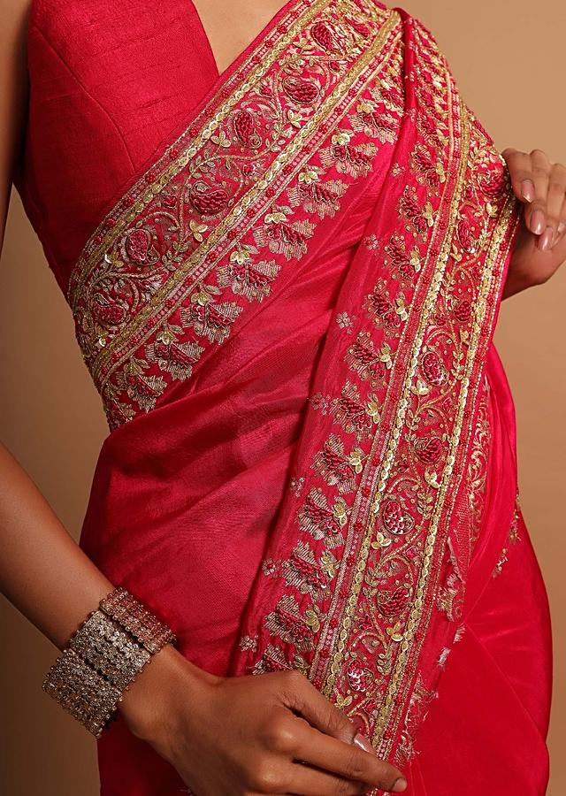 Fuchsia pink khadi silk saree embellished with hand embroideries s and weaved butti Online - Kalki Fashion