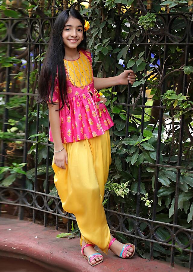 Fuchsia Pink Peplum Top With Printed Buttis And Yellow Dhoti Pants Online - Free Sparrow
