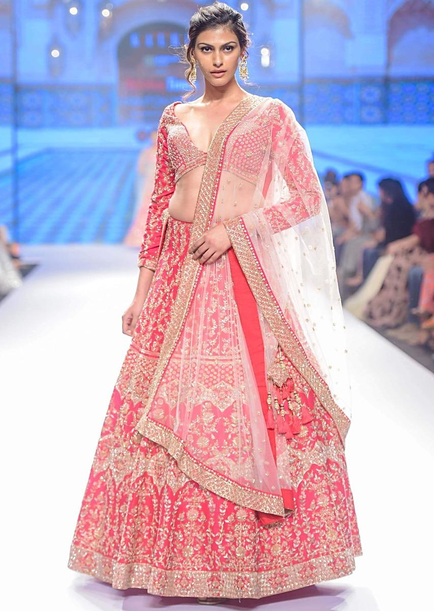 Fuchsia pink raw silk lehenga set in temple and floral embroidery