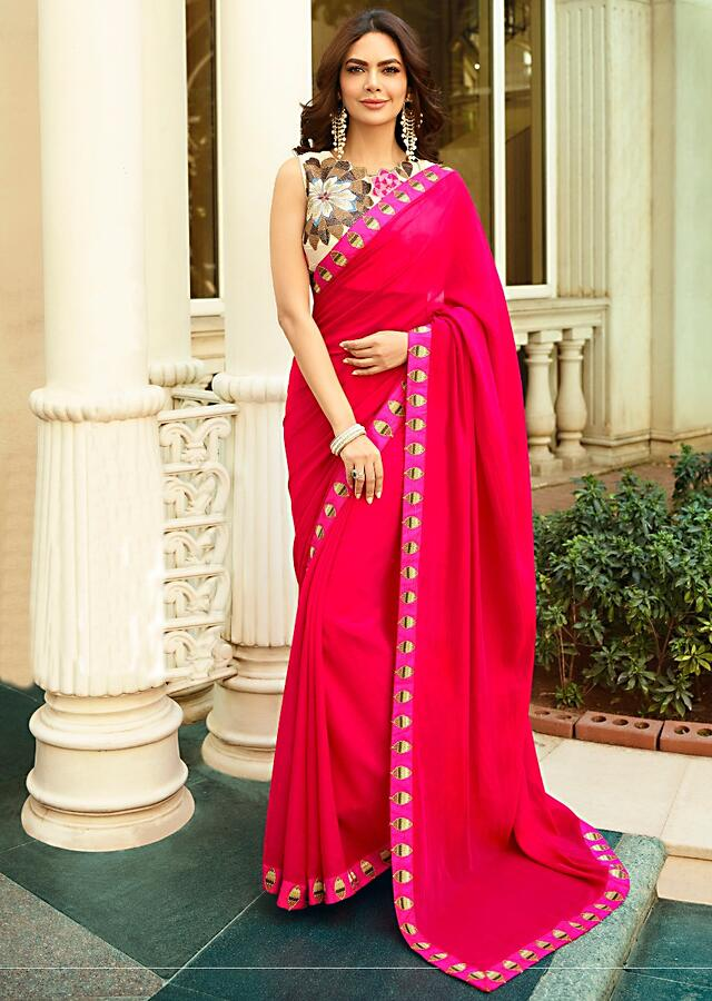 Fuchsia pink saree with floral embroidered unstitched blouse Online - Kalki Fashion