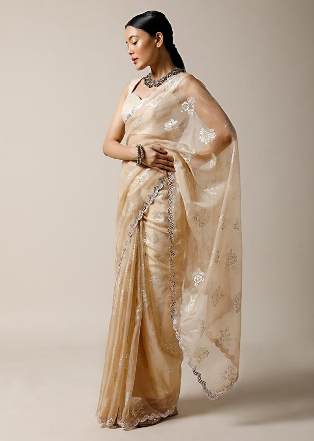 Gold Beige Saree In Organza With Foil Printed Floral Buttis And Mirror Work On The Border Along With Unstitched Blouse Online - Kalki Fashion