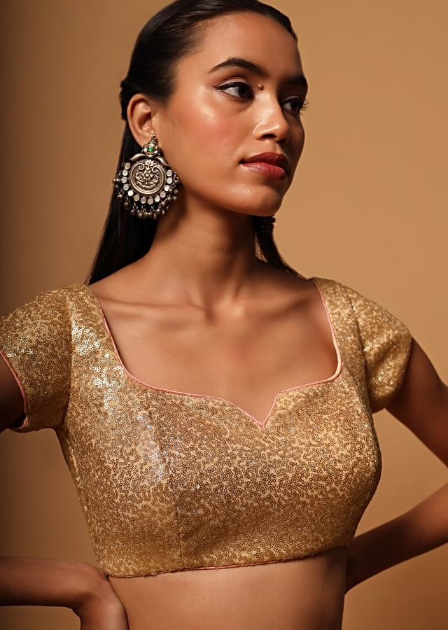 Gold Blouse In Net With Contrasting Peach Piping Around The Edges And Sequins Work All Over Online - Kalki Fashion