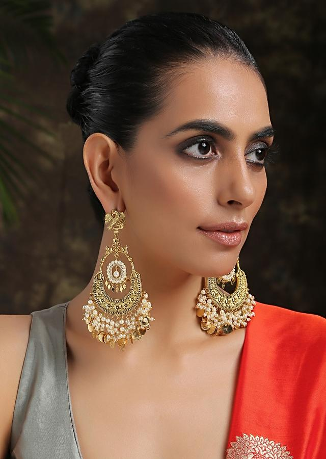 Gold Chandbali Earrings Adorned In Rich Shell Pearls And Intricate Temple Detailing By Paisley Pop