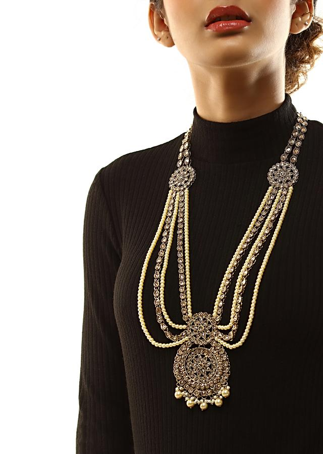Gold Long Layered Necklace With Crystal Embellished Floral Pendant And Moti Strings By Kohar