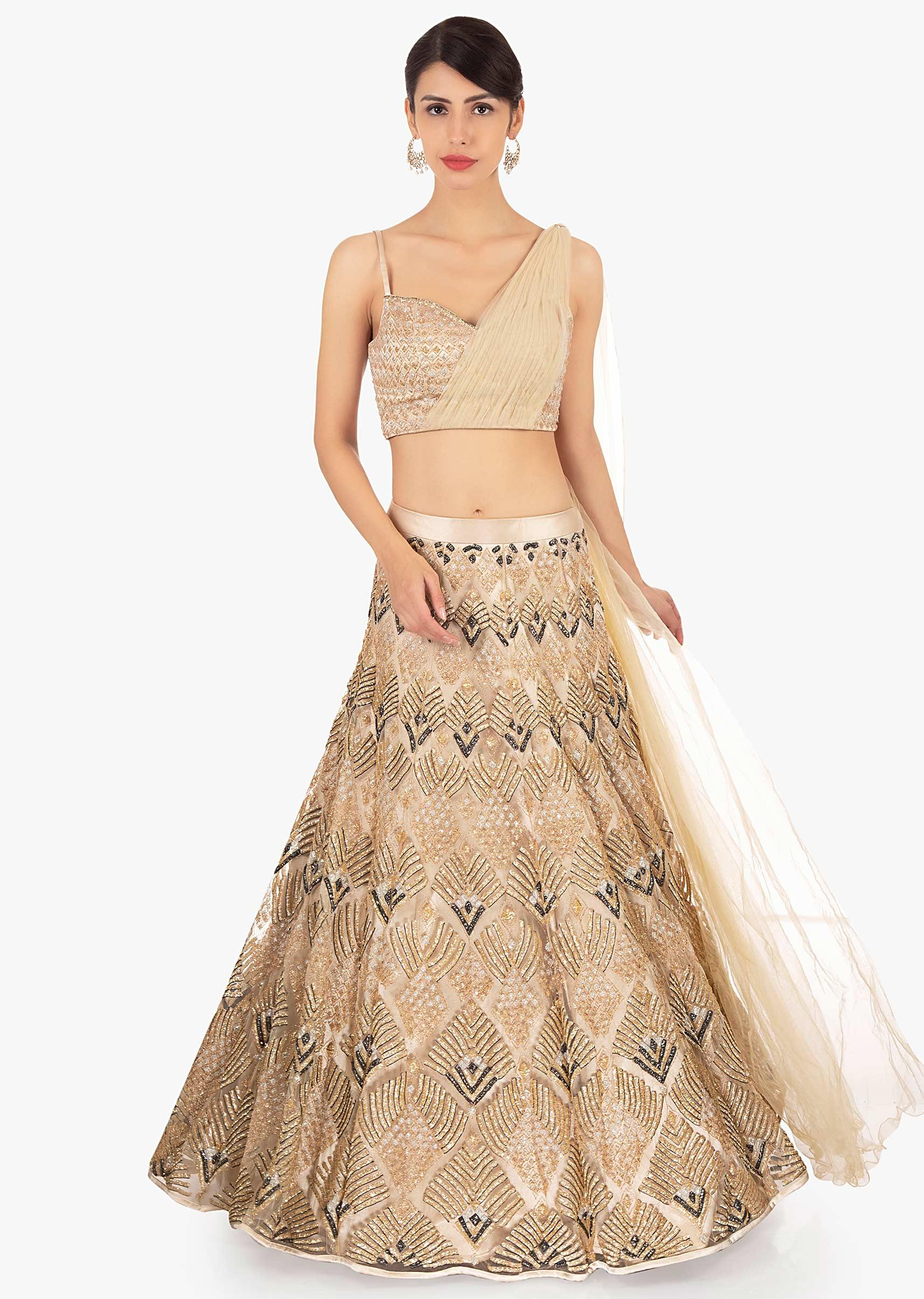 Gold net lehenga in geometric motif paired with a strap top with  preattached net dupatta only on KalkiMore Detail 558a395ff