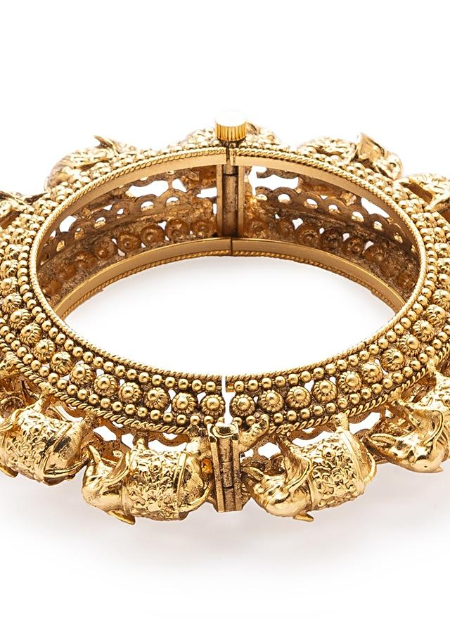 Gold Plated Bangle Designed With Carved Elephant Motifs Online - Joules By Radhika