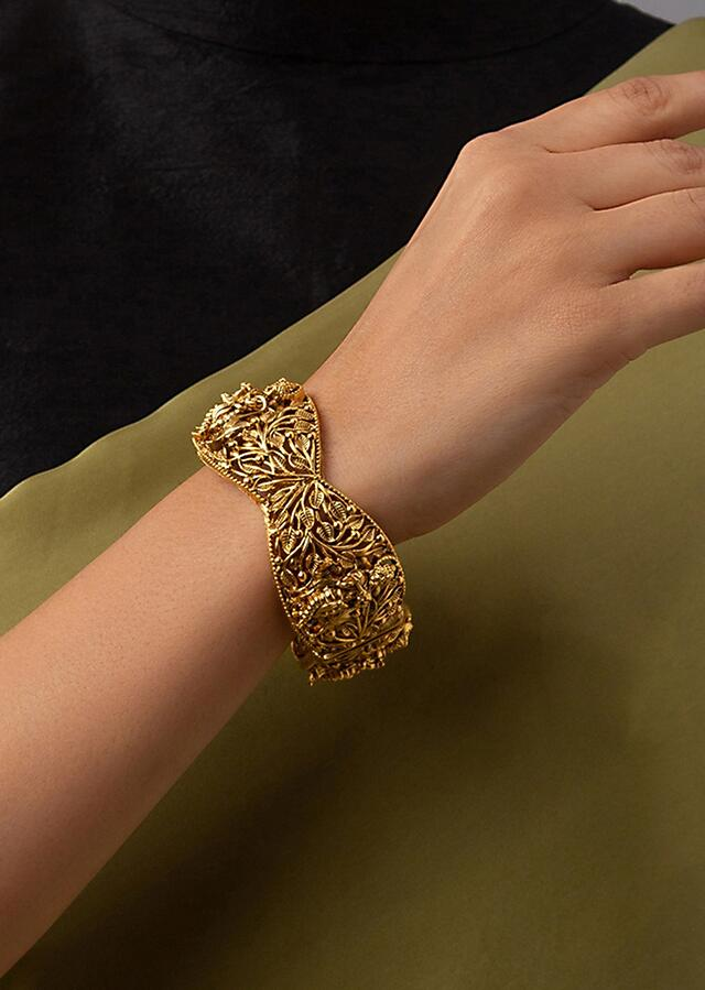 Gold Plated Bangle Designed With Hand Carved Ethnic Motifs  Online - Joules By Radhika