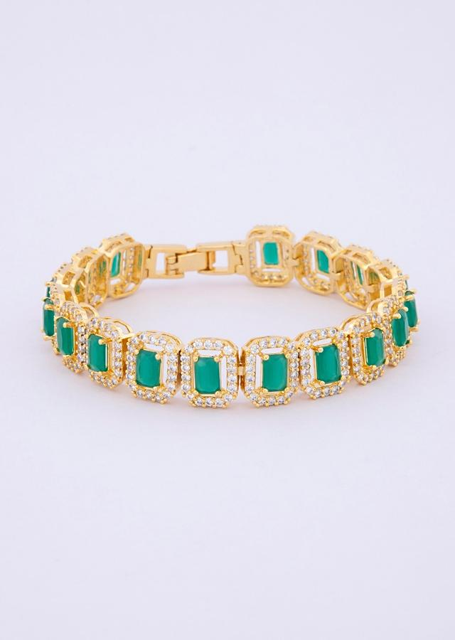 Gold plated bracelet adorn with CZ stones and green beads only on kalki
