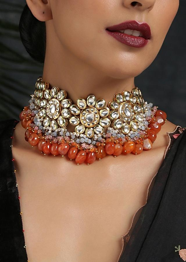 Gold Plated Choker Necklace Featuring Kundan Encrusted In Floral Motifs With Dangling Orange Beads And Multicolor Stones By Paisley Pop
