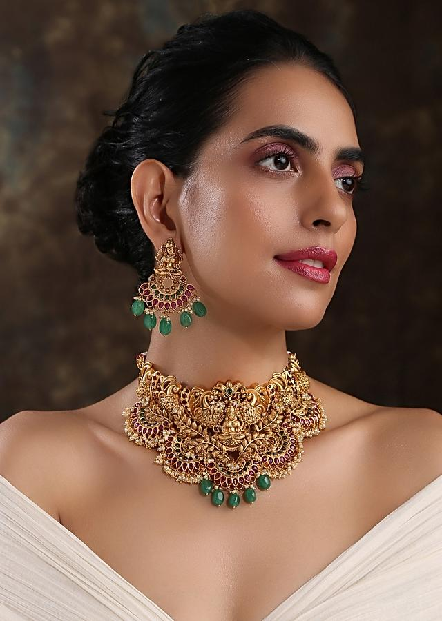 Gold Plated Choker Necklace Set Featuring Authentic Temple Work Studded With Red Stones And Dangling Green Beads By Paisley Pop