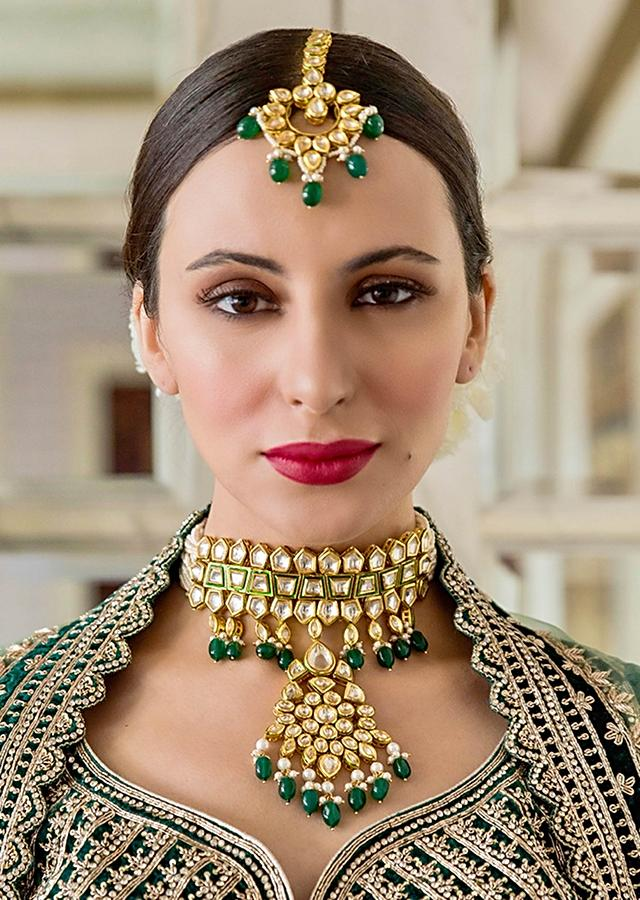 Gold Plated Choker Necklace With Elaborate Pendant In Exquisitely Cut Kundan And Green Beads By Prerto