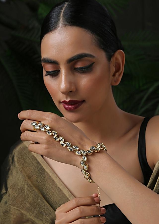 Gold Plated Hathphool Featuring Kundan Arranged In An Exquisite Pattern That Wraps Elegantly On Your Finger By Paisley Pop