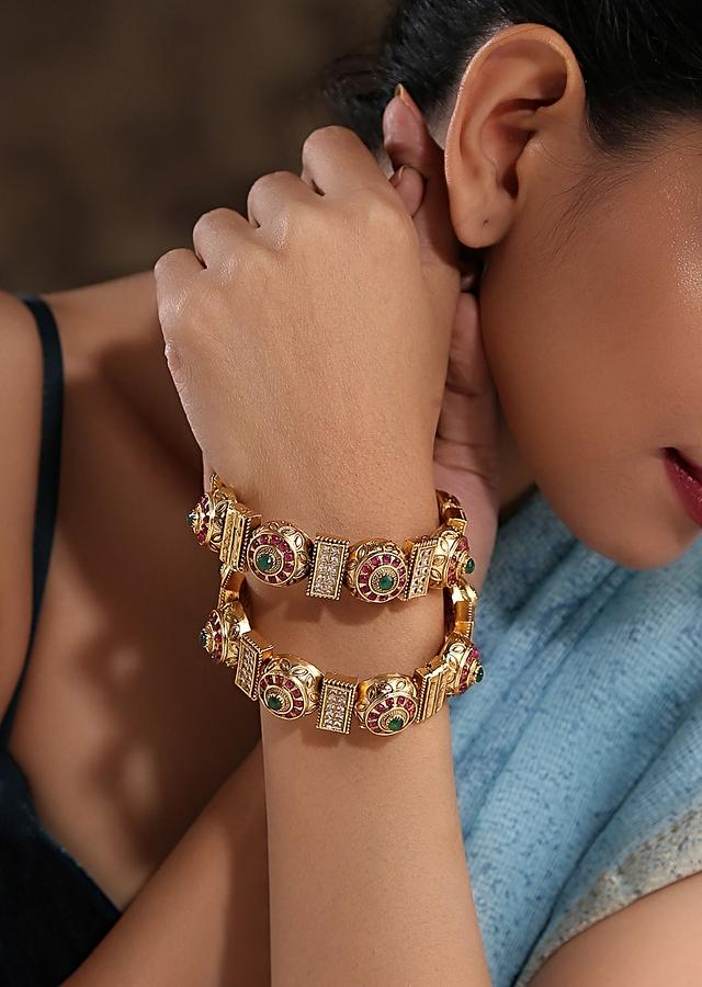 Gold Plated Kundan Bangles With Pink And Green Stones And Embossed Temple Work By Paisley Pop