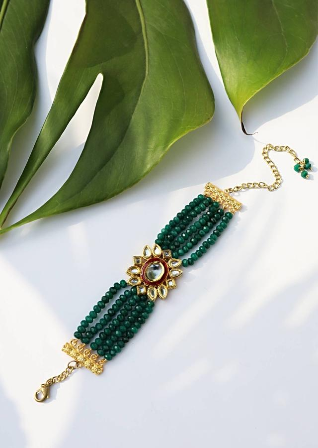 Gold Plated Kundan Bracelet With Emerald Green Stones Bead Strings And Mina Kari Detailing On The Edges By Paisley Pop