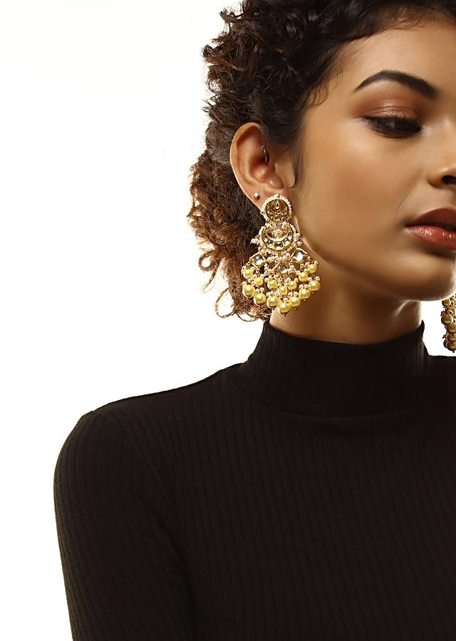 Gold Plated Kundan Earrings In Crescent Motifs With Dangling Yellow And White Pearl Fringes By Kohar