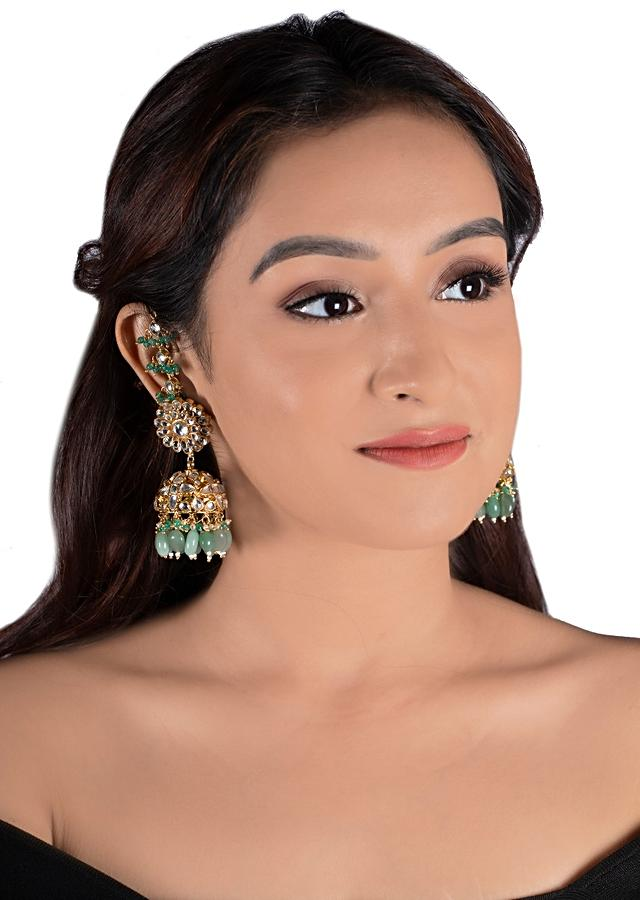 Gold Plated Kundan Jhumkas In Floral Design With Dangling Green Beads By Riana Jewellery