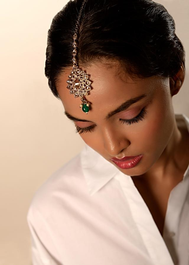 Gold Plated Mang Tika In Floral Motif With Semi Precious Crystals And Dangling Green Bead By Kohar