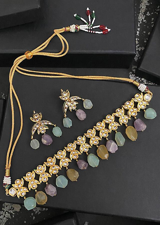 Gold Plated Necklace And Earrings Set Adorned In Kundan And Embellished With Dangling Emerald Pastel Stones By Paisley Pop