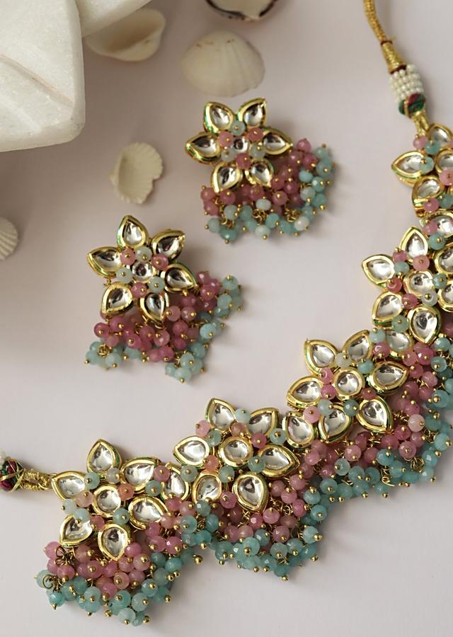 Gold Plated Necklace And Earrings Set With Kundan In Floral Motifs Along With Dangling Pink And Turquoise Beads By Paisley Pop