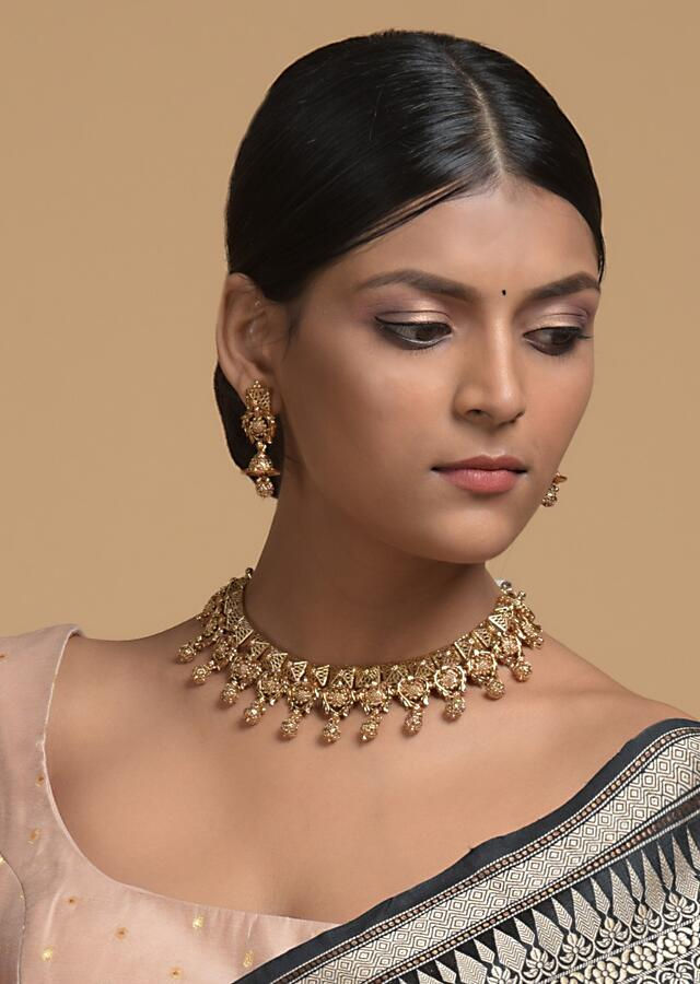 Gold Plated Necklace And Jhumka Set With Carved Geometric And Floral Design And Dangling Carved Beads Online - Kalki Fashion