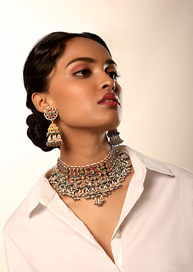 Gold Plated Necklace And Jhumkas With Carved Floral Motifs Embellished In Kundan And Semi Precious Stones In Shades Of Green And Pink By Kohar
