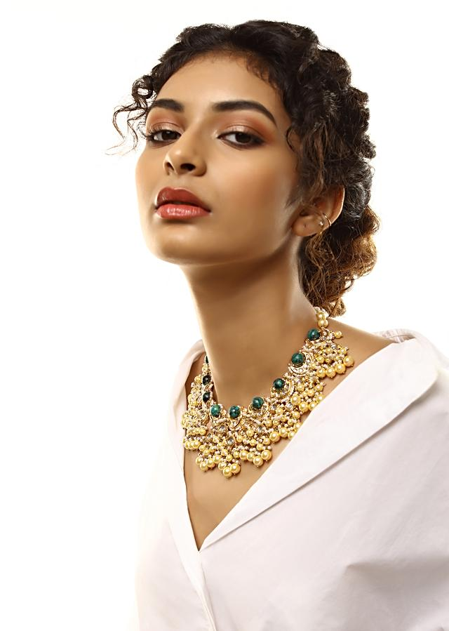 Gold Plated Necklace With Kundan Work In Crescent Shape With Green Semi Precious Spherical Stones And Pearl Fringes By Kohar