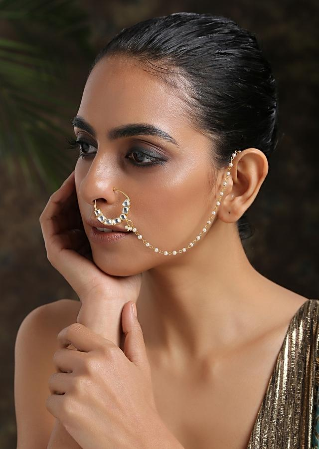 Gold Plated Nose Ring Intricately Put Together With Fascinating Shapes Of Kundan And Shell Pearl Detailing By Paisley Pop