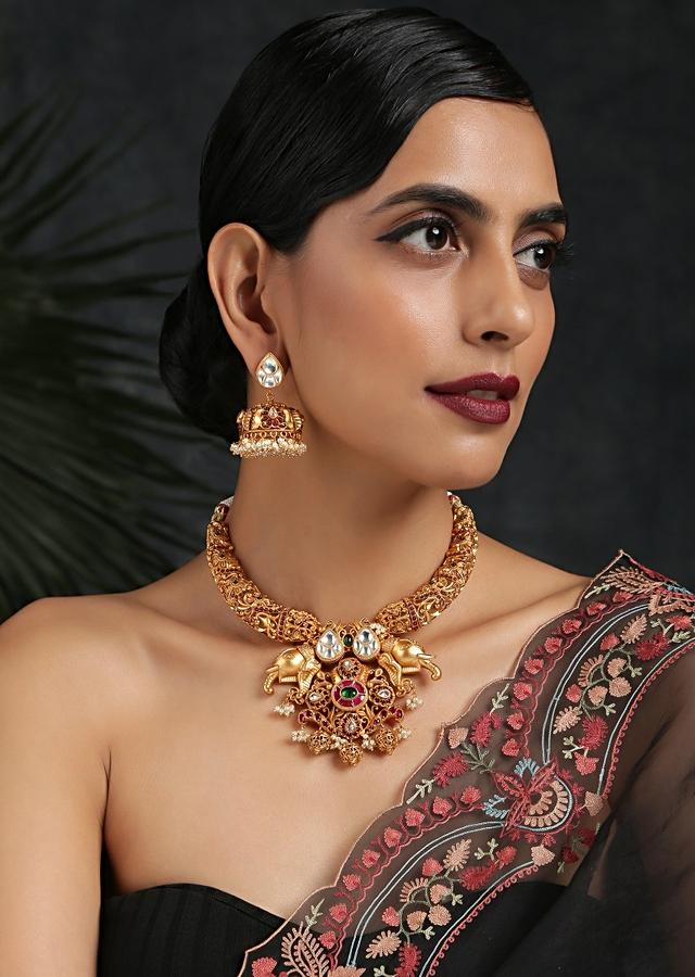 Gold Plated Temple Necklace Set Featuring Embossed Work, Elephant Motif Pendant And Studded With Red Stones By Paisley Pop