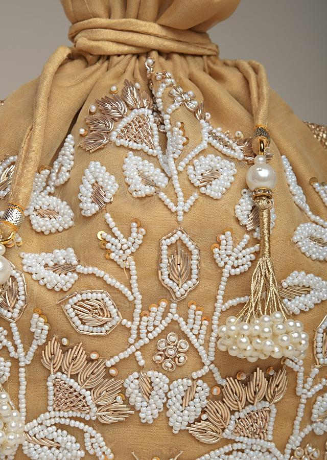 Gold Potli Bag In Raw Silk With Moti Embroidery In Floral Design Online - Kalki Fashion