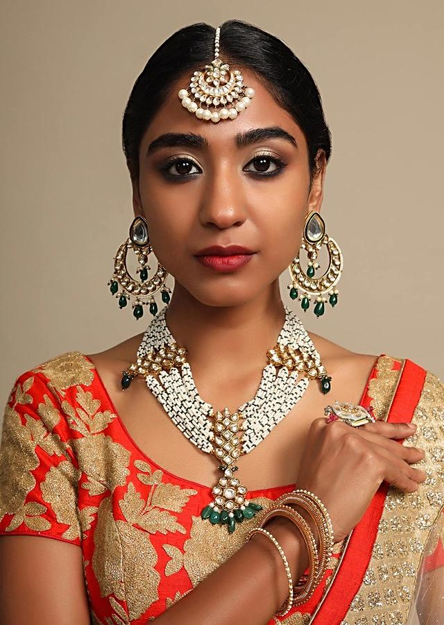 Gold Plated Mang Tika With Polki Work In Floral And Crescent Shape Along With Dangling Pearls Online - Kalki Fashion