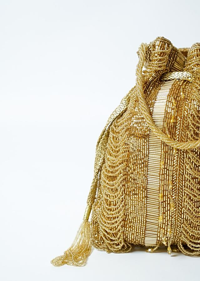 Gold Potli Bag In Raw Silk Hand Embroidered With Cut Dana And Bead Strings Online - Kalki Fashion