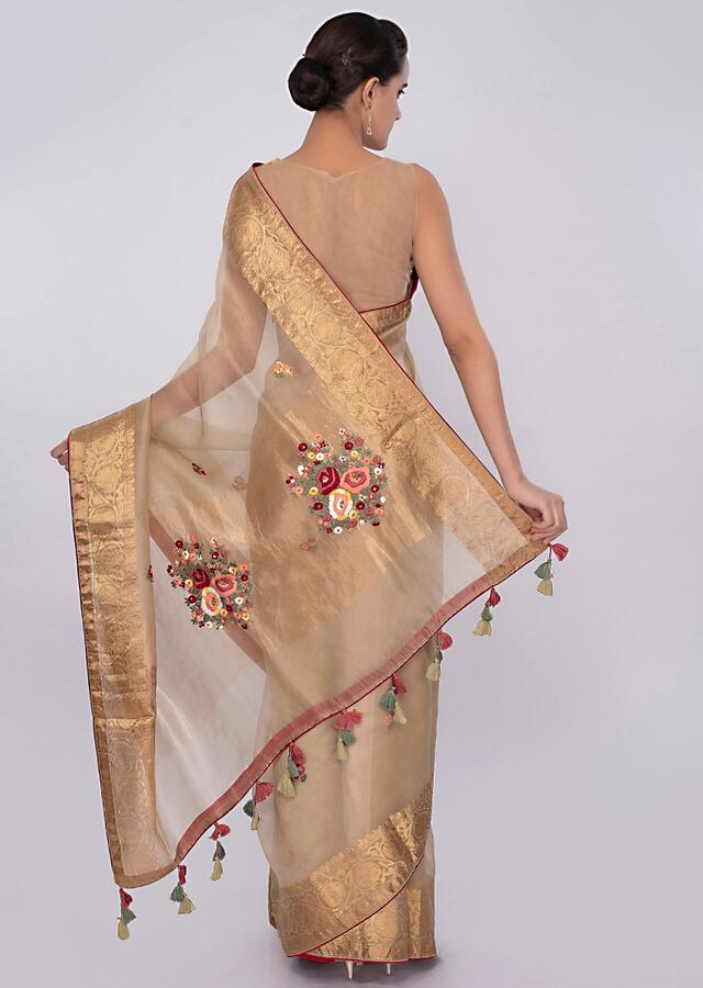 Golden beige organza saree with brocade border only on Kalki
