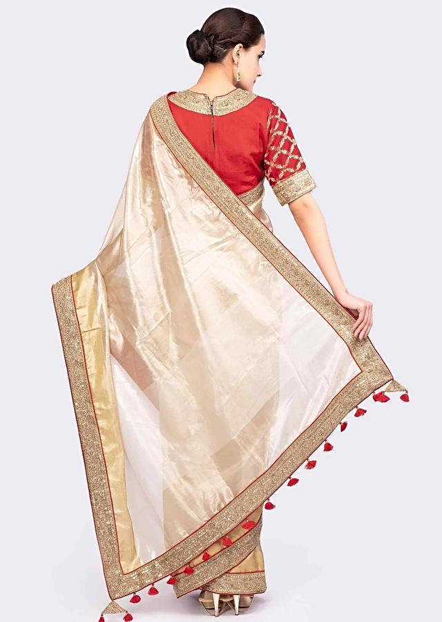 Golden Saree In Linen With Contrasting Red Brocade Silk Blouse Online - Kalki Fashion