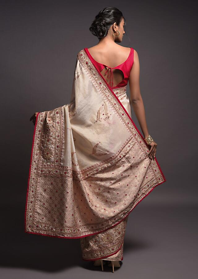 Golden White Saree In Dola Silk With Weaved Contemporary Motifs And Floral Pattern On The Border Online - Kalki Fashion