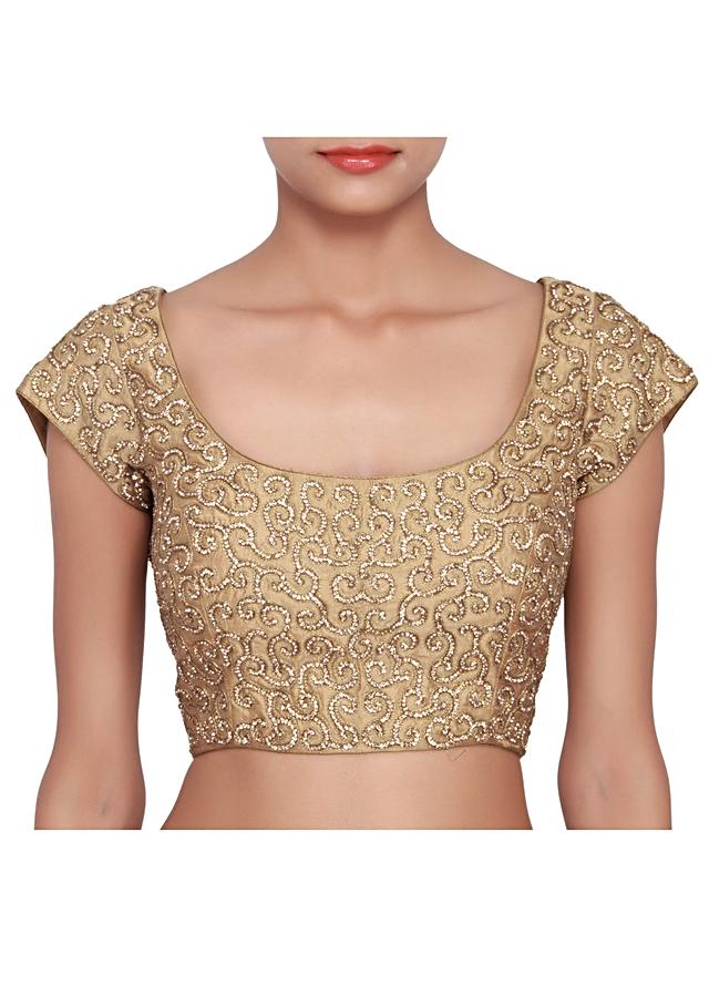 Golden blouse featured in raw silk, embellished in gold stone work over-all  only on Kalki
