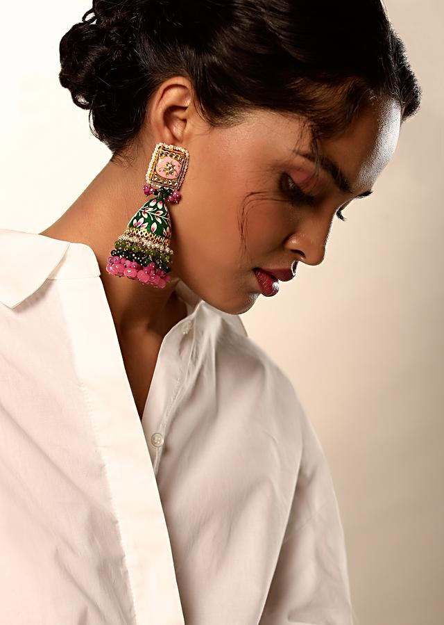 Green And Pink Jhumkas With Hand Painted Enamel Work Embellished With Kundan And Dangling Multi Colored Bead Fringes By Kohar