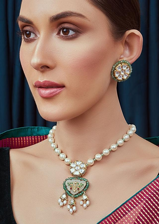White Pearl Necklace Set With Elaborate Pendant Made In Green Agates, Kundan and Fresh Water Pearls Joules By Radhika