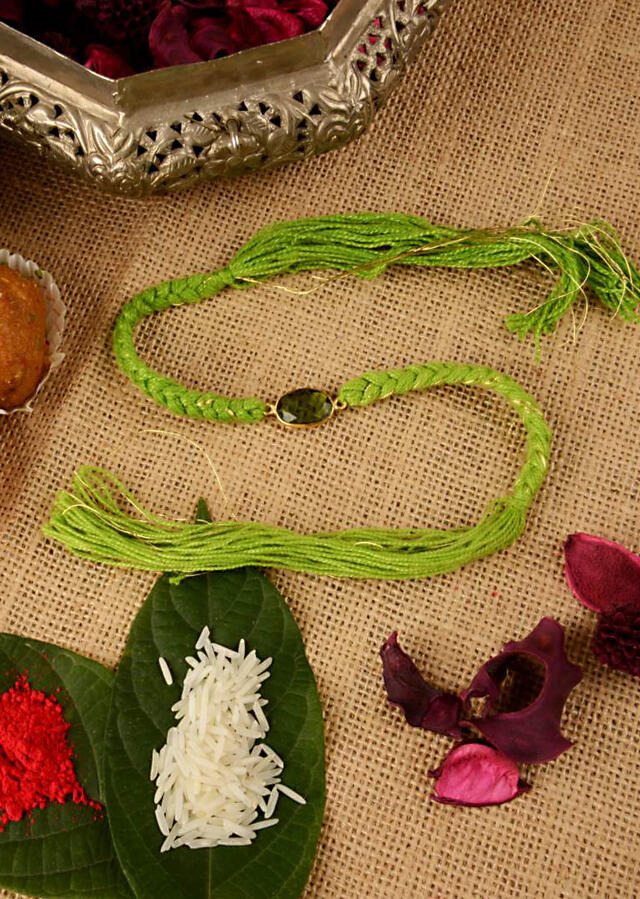 Green Colored Braided Rakhi In Gold And Green Thread Work Further Enhanced In Semi-Precious Moss Green Coloured Stone By Kohar
