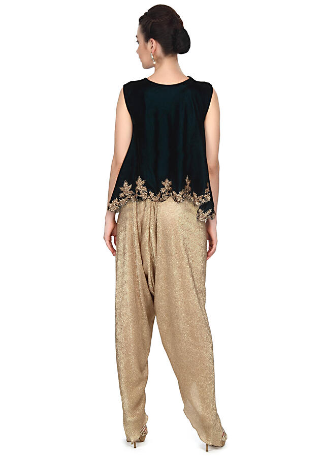 Green flared top matched with fancy dhoti pants only on Kalki