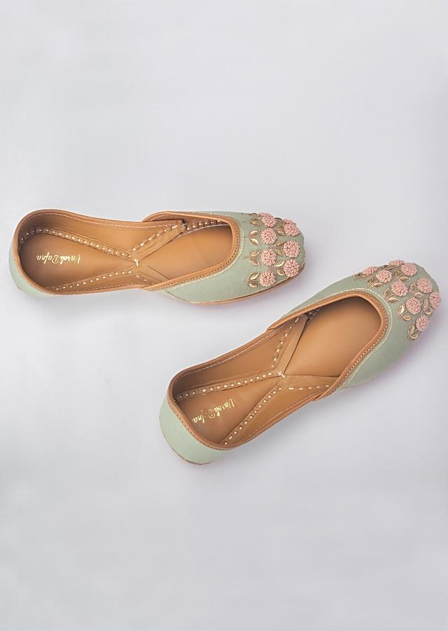 Green Juttis In Linen With Golden French Knot Flowers And Zari Leaves By Vareli Bafna