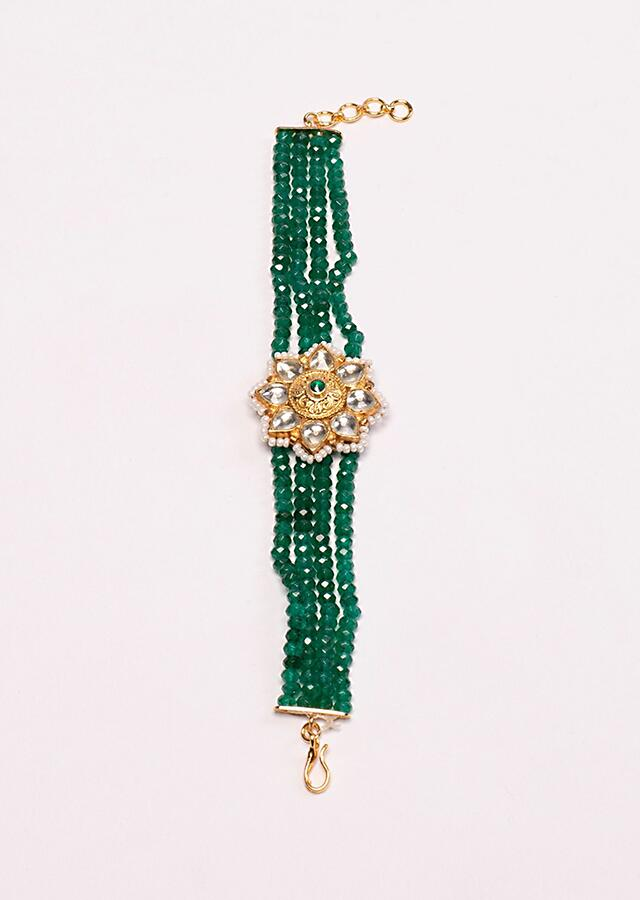 Green mullti layered braclet with floral broach at the center