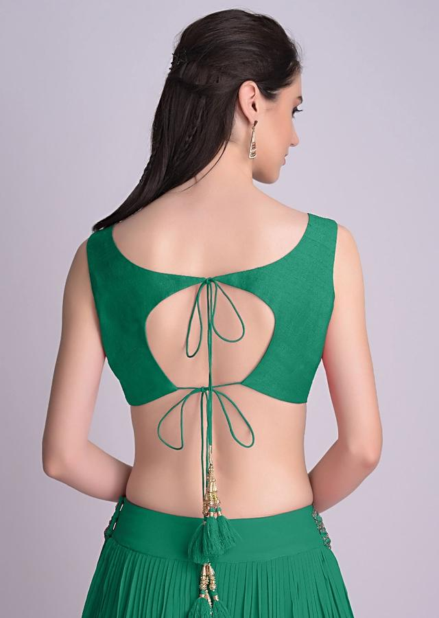 Green Sleeveless Blouse With Double Tie Up Tassel Dori At The Back Online - Kalki Fashion