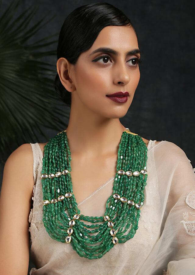 Green Stone Necklace With Multiple Strands Held Together With Gold Plated Kundan Highlights By Paisley Pop