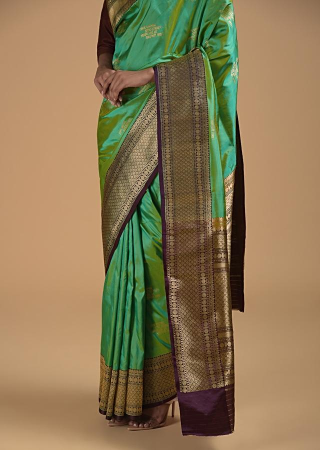 Green Two Toned Pure Handloom Saree In Silk With Woven Text Motifs And Purple Border Online - Kalki Fashion