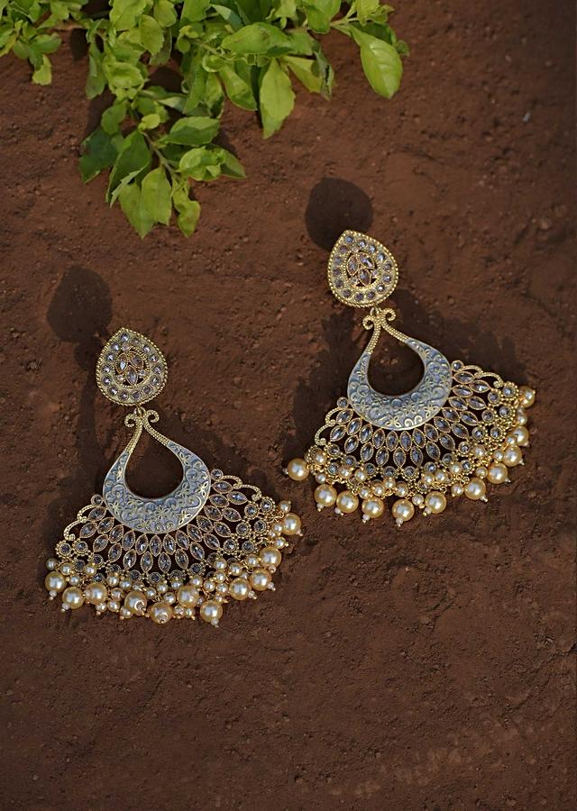 Grey Ethnic Earrings With Carved Floral Design Along With Crystals And Dangling Pearls Online - Kalki Fashion