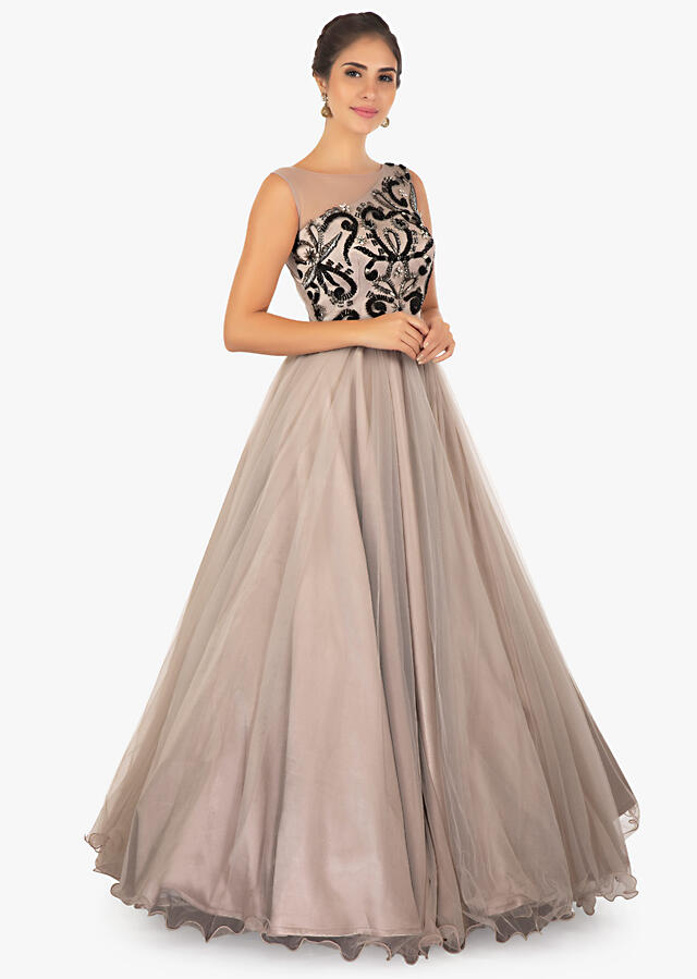Grey net gown embossed in sequins, cut dana and French knot on the bodice only on Kalki