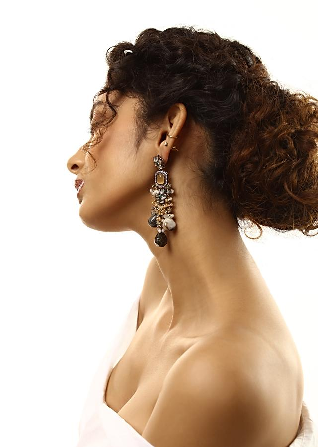 Grey Toned Earrings With Ochre Stones And Kundan In Floral Motifs Along With Dangling Stone Drops And Bead Fringes By Kohar